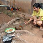 preparando il pranzo (luang prabang) - foto di andrea cassano